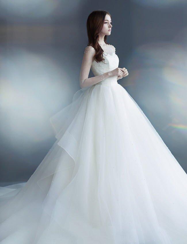 最美新娘发型中分波浪卷发图片