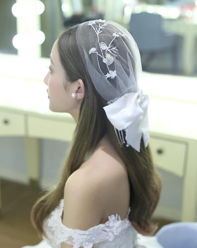 中分披肩长发时尚新娘发型图片