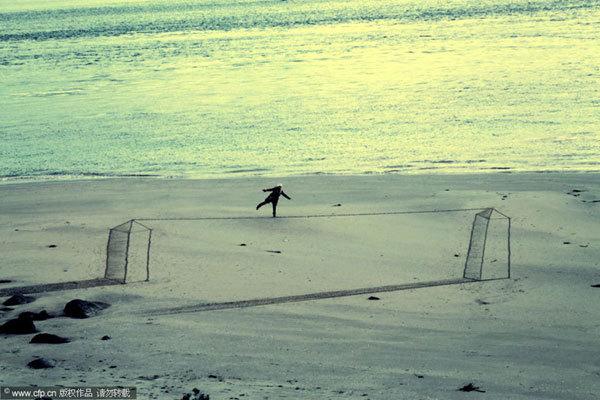 惊叹沙上走钢丝的人