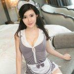 美女穿超短裙女仆装床上诱惑写真图片